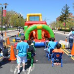 Children wait their turn for a chance at the inflatable slide.