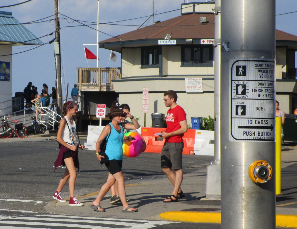 NJ AIM team member handing out pedestrian safety information in Point Pleasant, NJ
