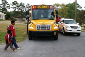 Illegally passing a stopped school bus can endanger children and their families. Image: Gloucester Township Police Department