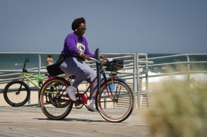 A woman bicycling in Asbury Park