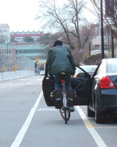 The dangers of a door zone bicycle lane (Source: Wikimedia).