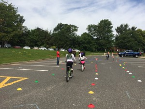 Students ride through course at Freehold Learning Center Rodeo while NJAIM Ambassador oversees