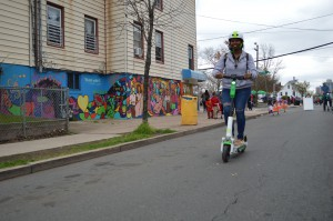 A Lime electric scooter being demonstrated during the April 2019 New Brunswick Ciclovia.